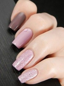 Beautiful winter nail art. The soft colors of light pink and mocha makes the nails look very pretty and cute. You can see silver heart shapes on the nails as well as embellishments and silver dust nail polish.