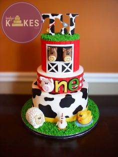 Farm Animal Cake E-I-E-I-O! All 3 tiers iced in buttercream. Barn, gingham, cow print, horses, pig, sheep, rooster, duck and topper are all Marshmallow Fondant.  Grass is buttercream.