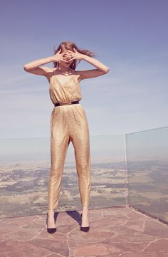 To keep warm this fall, add a cute bolero to this sparkly gold jumpsuit.