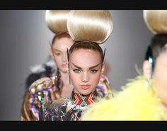 Mark Von Holden/Getty Images A model walks the runway at The Blonds fashion sho...