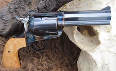 A Blackhawk in .500 JRH by Jason Menefee, featuring a 4½-inch octagon barrel with an integral rib and a custom white bar front sight (by Menefee), flat-topped frame, Smith & Wesson J-frame rear sight, reshaped XR3-RED grip, bird's-eye maple grips (by Menefee), modified Super Blackhawk hammer, and a five-shot fluted cylinder with blackpowder chamfer and click ratchet. It is finished in case color hardening by Turnbull. Photo by Jason Menefee