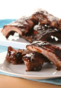 BBQ Ribs — Lime juice adds its tart kick to the tangy BBQ sauce in this great recipe for grilled pork baby back ribs.