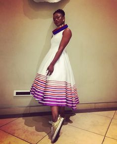 Unathi wearing this dress in white, accessorising it beautifully. We love the gold All Star sneakers. Best African Dresses, African Print Dresses, African Wear, African Attire, African Fashion Dresses, African Prints, South African Traditional Dresses, Traditional Outfits, Traditional Styles