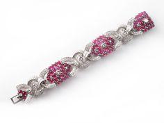 A platinum bracelet set with diamonds and cabochon rubies. France, 1930.