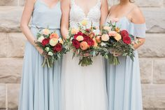 Summer bridal bouquet ideas | red and pink bouquet with greenery | Bride and bridesmaids bouquets | St Mary's Cathedral Wedding in Cheyenne Wyoming by Megan Lee Photography