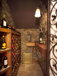 Space under the stairs turned into wine cellar!  GOOD USE OF SPACE!! Love the iron gate also, I really want to make this when we redo basement :)
