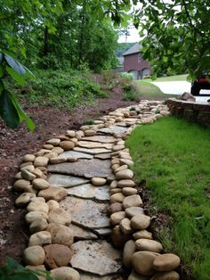 The flat stone fragments in the creek bed might make this a good footpath as well as a drainage feature.