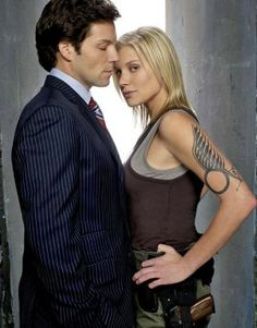 Apollo and Starbuck from BSG.  Click on the pic to link to an incredibly awesome Geekmom blog.  In the meantime, enjoy the incredible hotness of this pic and mourn the end of BSG some years back...