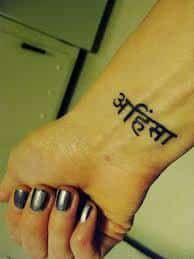 What does sanskrit tattoo mean? We have sanskrit tattoo ideas, designs, symbolism and we explain the meaning behind the tattoo. Ahimsa Tattoo, Sanskrit Tattoo, Pretty Tattoos, Beautiful Tattoos, Yoga Tattoos, Tatoos, Faith Tattoo On Wrist, Dragon Tattoo Back Piece, Vegan Tattoo
