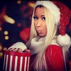 Pin for Later: Get Festive For the Holiday Season With the Cutest Celebrity Christmas Snaps of All Time!  In 2014, Nicki Minaj dressed up in a sultry Santa suit.