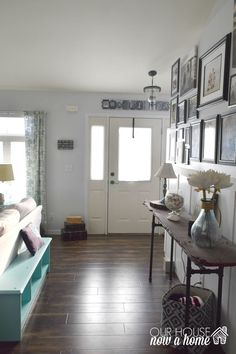 caostal-home-entry. simple ceiling light updates. Taking a home from builders grade to custom can be done with a few simple upgrades. Starting with changing out the ceiling lights, I am giving low cost solutions to upgrading the lighting i your home. To see more visit http://ourhousenowahome.com/ or click on the post