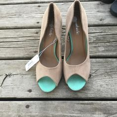 Charming Charlie heels NWT charming Charlie heels w/ mint green details. Has number written on bottom of shoe for some odd reason...Con post pic upon request.  Charming Charlie Shoes Heels