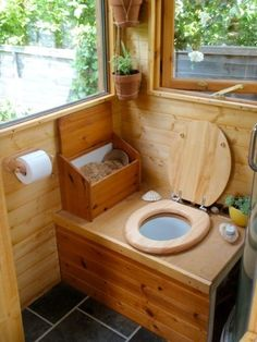 Tiny Cabin is Off Grid Luxury on a Budget Yep, a Humanure composting toilet in a trailer wagon.Yep, a Humanure composting toilet in a trailer wagon. Outhouse Bathroom, Tiny House Bathroom, Tiny Bathrooms, Wooden Bathroom, Bathroom Rugs, Small Bathroom, Yurt Living, Tiny House Living, Living Room