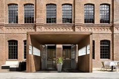 Sage Restaurant in Berlin, located in a former silk factory on the banks of the river Spree, features a raw industrial aesthetic and sky-high ceilings more commonly seen in the area's techno clubs; in warmer months, the scene spills onto the river bank beach.