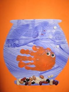 Handprint Fish Art. So easy and fun! Love the 'rocks.'    #handprint #kidscrafts
