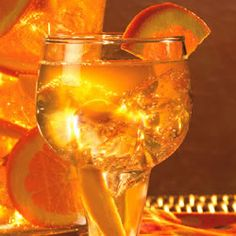 white sangria with peach schnapps, white wine, gingerale, oranges and peaches.