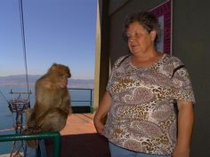 Moni next to a Gibraltar Barbary ape on the rock.