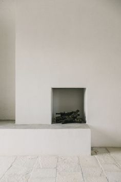 very minimal fireplace, white walls, allwhiteeverything