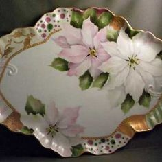 Painting of pink and white poinsettias by porcelain artist and teacher, Jane Wright.