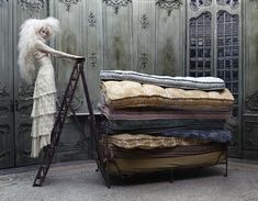 Beautiful Lace Dress w/a Princess in the Pea Pillow Mattress Theme...  Photog by Eugenio Recuenco