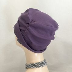 Chemo Hats - Soft Cotton Head Covering - Hats for Hair Loss - Alopecia Hats - Plum Jersey Hat - Slouchy Hat - Soft Beanie Hats - Beanies   A super soft head covering for anyone suffering hair loss, a great modesty head cover or just perfect for a bad hair day.  Makes a lovely get well gift.  Elegant in design given the pleating in the band yet simple to wear anywhere. The lower band can be turned up in various ways and if left down at the back gives deep head into neck coverage. Handmade in…
