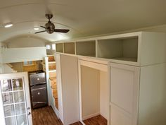 The shelving space above the fridge for the ability to stand up in the loft.
