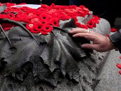 The Tomb of the Unknown Soldier at the National War Memorial in Ottawa is covered with poppies