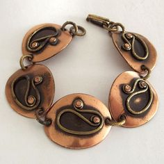 "Winifred Mason, Great Chenet d'Haiti Copper Ovals Bracelet.  This terrific bracelet is made of copper and gold tone metal and bears the mark Chenet d'Haiti.  Her jewelry is scarce to come by but worth the effort to find. This bracelet measures 7"" long by 7/8"" wide and is in very good previously owned condition. A wonderful piece by a truly talented and trailblazing lady.  Found on Rubylane Vintage jewelry site: http://www.rubylane.com/"
