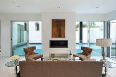 Pool views   Modern Living Area at Colgate in West Hollywood By Boswell Construction #buildboswell