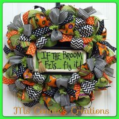 Halloween deco mesh wreath with six designs in ribbon and wood sign saying; If the broom fits fly it. Available on Ms Connie's Creations on Facebook. $70.00 (sold)