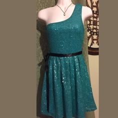 One shoulder sequin Aline dress Super flattering green sequin fully lined one shoulder ribbon missing out any kinda belt you like Pleated at  the waist.  Extremely flattering. Lilly rose Dresses One Shoulder