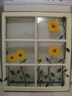Painted sunflowers on old window