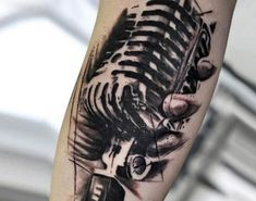 Realistic black and gray Microphone tattoo art by U Gene