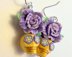 Purple and Yellow Day of the Dead Rose and Sugar Skull Earrings by PennysLane on Etsy Sugar Skull Earrings, Skull Bracelet, Skull Jewelry, Clay Jewelry, Beaded Jewelry, Beaded Earrings, Halloween Earrings, Halloween Jewelry, Earrings Handmade
