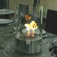 Freestanding-fireplace for the table top.  Awesome!