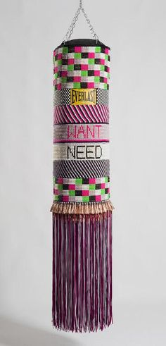 """""""What We Want, What We Need"""", Jeffrey Gibson, born 1972, Found punching bag, glass beads, artificial sinew, copper jingles, nylon fringe, and steel chain, 2014"""