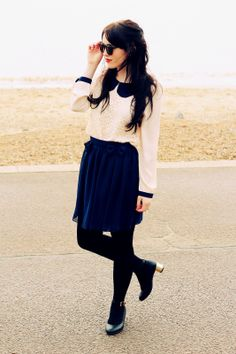 deep blue skirt and cream lace top with dark blue collars