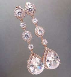 (Sponsored) With a solid diamond formed post on the prime that tapers off with two tiers of glowing teardrop crystals, these earrings scream creative, inventive glamour. Exquisite ornate detail, crystal, zirconia and an extended size perfectly come collectively for a look that may catch eyes from every direction. These lovely Chandelier earrings by BHLDN maintain it fashionable and stylish. We love the crystal design sample with petal-shape crystals jutting out from the bottom. Chandelier e... Rose Gold Drop Earrings, Gold Bridal Earrings, Rose Gold Jewelry, Bridesmaid Earrings, Crystal Earrings, Silver Earrings, Bridal Necklace, Teardrop Earrings, Chandelier Earrings