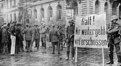 Halt! Anyone who passes will be shot! Freikorps members from the Trench Mortar Detachment Heuschkel block a Berlin street against Communist demonstrators in March of 1919.