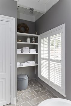 LOVE these white shutters in this gray bathroom! Grey Bathrooms, Beautiful Bathrooms, My Living Room, Home And Living, White Shutters, Window Shutters, Laundry In Bathroom, Laundry Hamper, Bathroom Storage