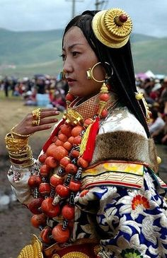Tibet | 'Her costume was exceptional in it's composition and and in the quality of every single piece. monumentally sized amulets with intricate and beautiful engravings and a beautifully proportioned set of coral and dzi necklaces make this one of the most beautiful khampa costumes I have seen' | Image and caption © BetterWorld2010.