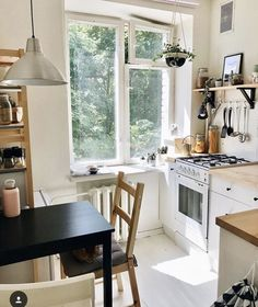 Great idea for a small apartment kitchen. I love the natural light and the white everywhere. Condo Living, Apartment Living, Living Spaces, Small Apartment Interior, Small Apartment Kitchen, The Home Edit, Relaxation Room, Up House, Small Apartments