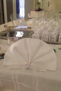 Table setting done by me... bomboniere hand made and designed by me.. fabric napkins folded by myself ...