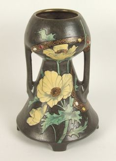 ART NOUVEAU POTTERY VASE. Art Nouveau pottery vase, two handled form with poppy design with jeweled and gilt meandering band highlights.