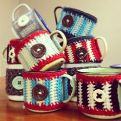 copyright of tjou-tjou, all rights reserved by henriette rademan one of my learners fell in love with our mug-cosies and ordered . Table Decorations, Mugs, Tableware, Dinnerware, Tablewares, Mug, Place Settings, Dinner Table Decorations