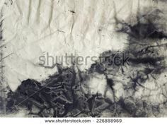 Abstract black and white ink painting on grunge paper texture.