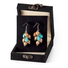 @WorldCrafts {Jordanian Earrings ~ Glad Tidings ~ Jordan} Olive wood beads combined with turquoise stones make these earrings truly unique. From each sale of an item, the artisans—who are hearing-impaired or otherwise disabled—can afford to buy precious commodities such as food, clothing, shelter, and education. #fairtrade