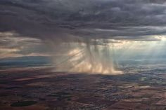 Airplane view of a distant storm over Denver, Colorado. Incredible. (Photo by Haley Luna)