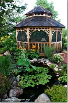 Absolutely beautiful garden area, looks like the gazebo is also lined with mosquito netting, smart move.