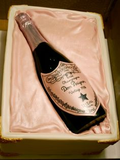 Cake for my pregger friend's birthday! Solid chocolate champagne bottle with handpainted label on top of a fondant covered cake